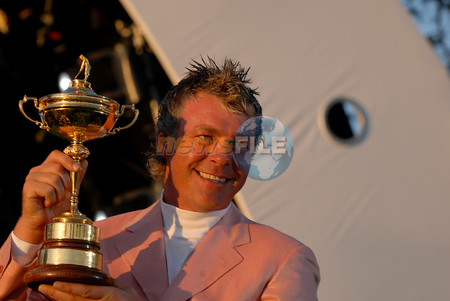 Darren Clarke, part of the victorious European Team holds the Ryder Cup during the closing ceremony of the 2006 Ryder Cup at The K Club..Photo: Eoin Clarke/Newsfile.
