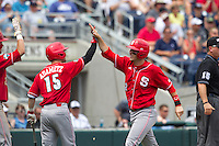 North Carolina State Wolfpack third baseman Grant Clyde #22 celebrates with outfielder Bryan Adametz #15 during Game 3 of the 2013 Men's College World Series between the North Carolina State Wolfpack and North Carolina Tar Heels at TD Ameritrade Park on June 16, 2013 in Omaha, Nebraska. The Wolfpack defeated the Tar Heels 8-1. (Brace Hemmelgarn/Four Seam Images)