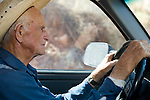 """Aug 9, 2008 -- COLORADO CITY, AZ: JOSEPH JESSOP, 86, patriarch of the Jessop family, polygamists and members of FLDS in Colorado City, AZ, drives his pickup truck through town. Colorado City and neighboring town of Hildale, UT, are home to the Fundamentalist Church of Jesus Christ of Latter Day Saints (FLDS) which split from the mainstream Church of Jesus Christ of Latter Day Saints (Mormons) after the Mormons banned plural marriage (polygamy) in 1890 so that Utah could gain statehood into the United States. The FLDS Prophet (leader), Warren Jeffs, has been convicted in Utah of """"rape as an accomplice"""" for arranging the marriage of teenage girl to her cousin and is currently on trial for similar, those less serious, charges in Arizona. After Texas child protection authorities raided the Yearning for Zion Ranch, (the FLDS compound in Eldorado, TX) many members of the FLDS community in Colorado City/Hildale fear either Arizona or Utah authorities could raid their homes in the same way. Older members of the community still remember the Short Creek Raid of 1953 when Arizona authorities using National Guard troops, raided the community, arresting the men and placing women and children in """"protective"""" custody. After two years in foster care, the women and children returned to their homes. After the raid, the FLDS Church eliminated any connection to the """"Short Creek raid"""" by renaming their town Colorado City in Arizona and Hildale in Utah. A member of the Jessop family weeds the community corn plot in Colorado City, AZ. The Jessops are a polygamous family and members of the FLDS.     Photo by Jack Kurtz / ZUMA Press"""