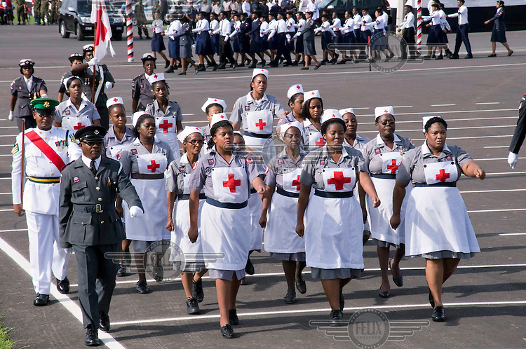 A delegation of nurses march in Queens Park Savannah during Independence Day celebrations. The island gained its independence on 31st August 1962.