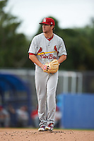 Palm Beach Cardinals pitcher Corey Littrell (21) gets ready to deliver a pitch during the second game of a doubleheader against the Dunedin Blue Jays on August 2, 2015 at Florida Auto Exchange Stadium in Dunedin, Florida.  Dunedin defeated Palm Beach 2-0.  (Mike Janes/Four Seam Images)
