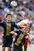 Roy Miller (7) of the New York Red Bulls goes up for a header with Stefani Miglioranzi (6) and Sebastien Le Toux (9) of the Philadelphia Union during a Major League Soccer (MLS) match at Red Bull Arena in Harrison, NJ, on April 24, 2010.