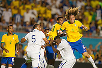 Miami, FL - Saturday, Nov 16, 2013: Brazil vs Honduras during an international friendly at Miami's Sun Life Stadium. Brazil defender David Luiz try a header after a corner kick.