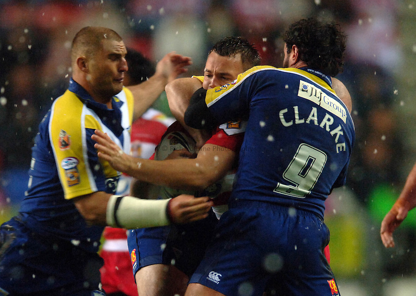 Photo: Paul Greenwood..Wigan Warriors v Warrington Wolves. Engage Super League 2007. 09/02/2007. Warrington's Jon Clarke (right) stops Wigan's Eamon O'Carroll in his tracks