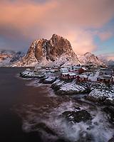 Traditional red Rorbu fishermen cabins on rocky coastline of Hamnøy, Lofoten Islands, Norway