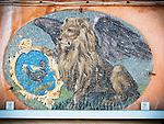 Winged lion of St. Mark mosaic details along Fondamenta dei Vetrai on the main canal of Murano, Italy