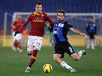 Calcio, ottavi di finale di Coppa Italia: Roma vs Atalanta. Roma, stadio Olimpico, 11 dicembre 2012..AS Roma forward Nico Lopez, of Uruguay, is challenged by Atalanta defender Stefano Lucchini, right, during their Italy Cup last-16 tie football match between AS Roma and Atalanta at Rome's Olympic stadium, 11 december 2012. .UPDATE IMAGES PRESS/Isabella Bonotto