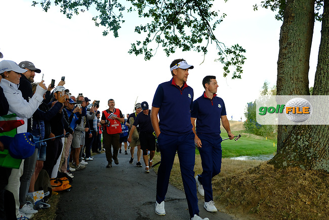 Ian Poulter (Team Europe) and Rory McIlroy (Team Europe) during the friday foursomes at the Ryder Cup, Le Golf National, Ile-de-France, France. 28/09/2018.<br /> Picture Fran Caffrey / Golffile.ie<br /> <br /> All photo usage must carry mandatory copyright credit (© Golffile | Fran Caffrey)