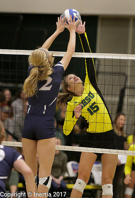 SPEARFISH, SD: SEPTEMBER 29:  Laurel Lech #15 of Black Hills State hits toward the blocking hands of Abby Tiesman #12 of Colorado Mines during their college volleyball match Friday at the Donald E. Young Center in Spearfish, S.D.   (Photo by Dick Carlson/Inertia)