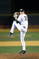 Wake Forest Demon Deacons relief pitcher Rayne Supple (30) in action against the Georgetown Hoyas at David F. Couch Ballpark on February 19, 2016 in Winston-Salem, North Carolina.  The Demon Deacons defeated the Hoyas 3-1.  (Brian Westerholt/Four Seam Images)