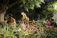 """Visitors are seen inside the Creation Museum in Petersburg, Kentucky on January 3, 2013.  The Creation Museum teaches the difference between """"man's law"""" and """"god's law,"""" disputing evolution, evolutionary science and other teachings that eschew the Bible."""