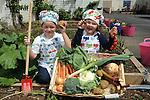 Tiernan O'Cuarnain, (5) and Amy Budhlaeir, (5) from Bunscoil an Chlochair in Dingle, County Kerry pictured tending to their school vegetable garden on Tuesday as they helped celebrate Dingle's victory in the  Best Foodie Town in Ireland competition run by the Restaurant Association in Ireland.<br /> Picture by Don MacMonagle<br /> <br /> REPRO FREE PJHOTO; <br /> PRESS RELEASE;<br /> Last night at the most prestigious Restaurant Awards in Ireland, hosted by the Restaurant Association of Ireland, Dingle's reputation as a must-go food destination was cemented. Fenton's Restaurant was voted the best casual dining restaurant in Ireland and The Global Village Restaurant was awarded the top gong for Emerging Irish Cuisine.  But the most exciting Award was that of Best Foodiest Town In Ireland, which Dingle was Awarded against the likes of Kinsale, Loop Head, West Cork, Howth and several other well known culinary destinations.   Says John Sheehy, head of the Dingle Chambers of Commerce which has consistently driven the town's food offering.  &quot;We have it all in Dingle; an amazing setting, great restaurants and pubs. We engage the whole community in buying local and serving local. We have great seafood from Dingle Bay and the mountains that surround us provide the best of Kerry lamb and beef.&quot;<br />  As well as the hugely popular Dingle Peninsula fFood Festival over the first weekend in October,  Dingle has also been the birth place of the Blas na hEreann, Irish Food Awards, the most prestigious quality accreditation that any producer can get for their produce.  Last year, the the final judging of this competition saw over 350 judges blind taste over 2000 products to find the best that Ireland has to offer.  The Awards Presentation takes place during the Festival when the town turns into a Mecca for producers, chefs, food writers and food lovers alike.<br /> <br /> &gt; Food Critic and Author Katie McGuinness &quot;In food terms, Dingle has it all. Great ingredients, committed producers, terrific restaurants, and a community that