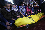 Relatives of Palestinian farmer Mahdi Ermelat, 36, mourn during his funeral in Rafah in the southern Gaza Strip January 19, 2020. Ermelat, was announced dead in the explosion while another man was critically injured, and was moved to nearby Abu Yousef Al-Najjar Hospital for treatment. Photo by Ashraf Amra