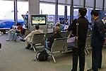 People watching Sumo wrestling in Narita, Japan airport.
