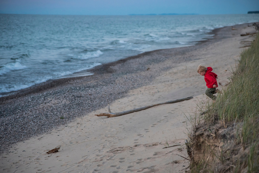 Kids explore and play during unset on a Lake Superior beach on Michigan's Upper Peninsula.