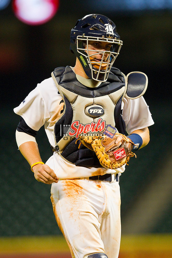Catcher Geoff Perrott #28 of the Rice Owls on defense against the Kentucky Wildcats at Minute Maid Park on March 4, 2011 in Houston, Texas.  Photo by Brian Westerholt / Four Seam Images