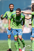 Seattle Sounders FC midfielder Lamar Neagle (27) celebrates with teammates after scoring a goal against Columbus Crew at CenturyLink Field in Seattle, Washington. The Sounders defeated Columbus Crew, 6-2.
