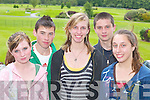 WELCOME: Killarney teenagers Gavin Corbett and Gary OShea welcome, l-r, Ashley.Prince, Chelsea Trunk and Maggie Trunk from Charlotte, North Carolina, USA, to Ireland,.when they met at Killarney racecourse last Monday evening.