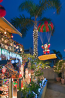 Surfing Santa, Christmas, Lights, Treasure Island, Naples, Long Beach, CA; Reflecting in Canal; Close up; Boats; Houses; Lights; Sailboats; Yachts; holiday; holidays; travel; usa; vacation;  Architecture, Los Angeles CA; LA;  California; High dynamic range imaging (HDRI or HDR)