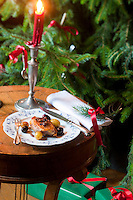 A delicate pheasant and grape salad served on a candle-lit table for Christmas dinner