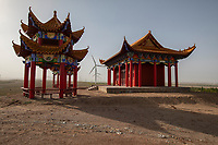 China - Ningxia - A Buddhist temple located in the land belonging to Pigeon Hill Winery. The wind turbines in the back are used to supply energy the winery.