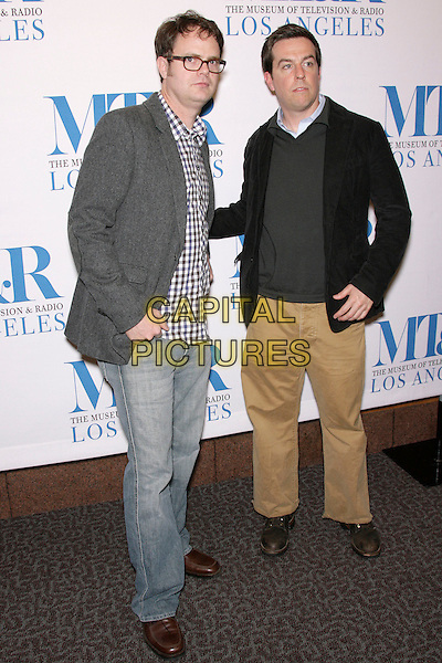 "RAINN WILSON & ED HELMS.The 24th Annual William S. Paley Television Festival - An Evening with ""The Office"" held at the Directors Guild of America, Los Angeles, California, USA..March 2nd, 2007.full length glasses grey gray suit jacket black jeans denim brown trousers .CAP/ADM/ZL.©Zach Lipp/AdMedia/Capital Pictures"