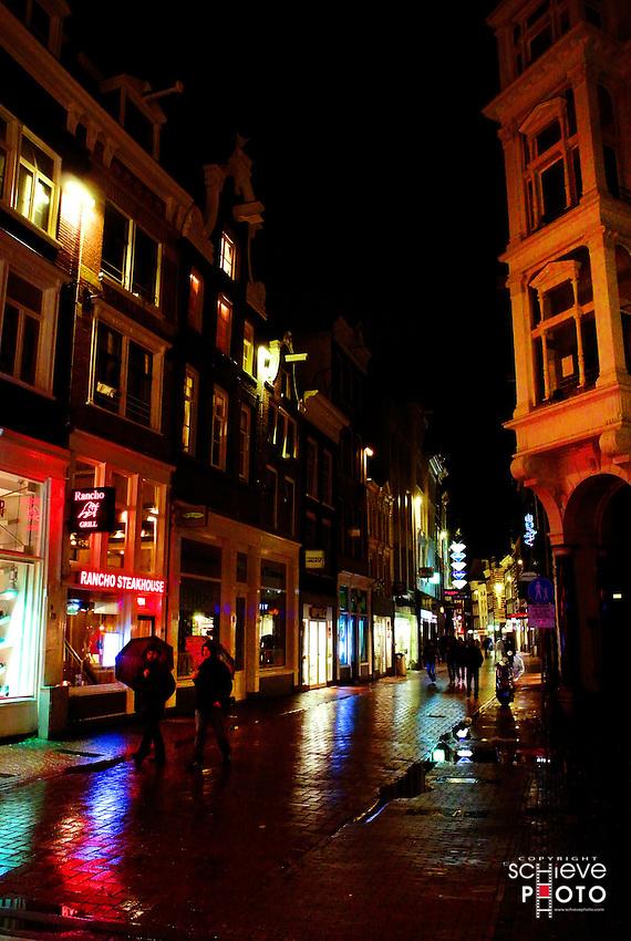 Amsterdam city street at night.