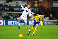 Oli McBurnie of Swansea City battles with Craig Gardner of Birmingham City during the Sky Bet Championship match between Swansea City and Birmingham City at the Liberty Stadium in Swansea, Wales, UK. Tuesday 29 January 2019