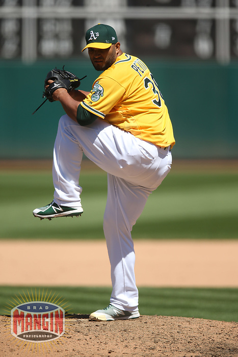 OAKLAND, CA - MAY 9:  Yusmeiro Petit #36 of the Oakland Athletics pitches against the Houston Astros during the game at the Oakland Coliseum on Wednesday, May 9, 2018 in Oakland, California. (Photo by Brad Mangin)