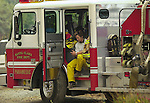 August 21, 2001 Coulterville, California  -- Creek Fire – Santa Clara firefighter takes a break. The Creek Fire burned 11,500 acres between Highway 49 and Priest-Coulterville Road a few miles north of Coulterville, California.