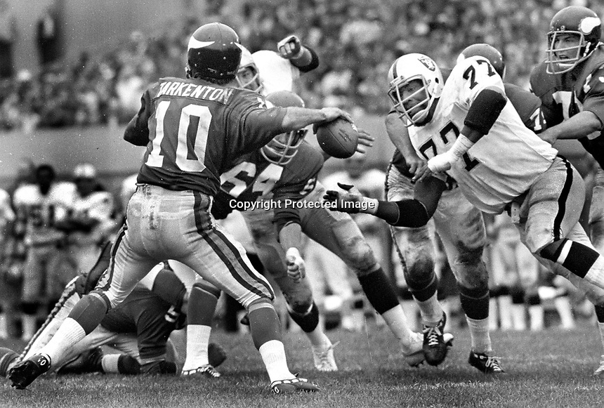 Oakland Raiders Bubby Smith puts the rush on Minnesota Vikings QB Fran Tarkenton...(1873 photo/Ron Riesterer)