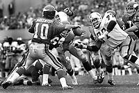 Oakland Raiders Bubby Smith puts the rush on Minnesota Vikings QB Fran Tarkenton...(1873 photo/Ron Riesterer)