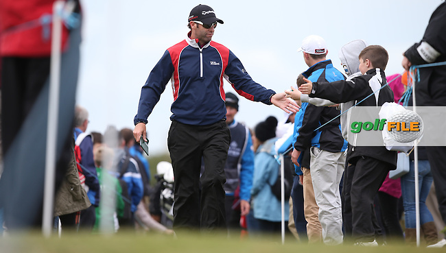 High fives through the gap en route to the 18th for Bradley Dredge (WAL) during Round Three of the 2015 Dubai Duty Free Irish Open Hosted by The Rory Foundation at Royal County Down Golf Club, Newcastle County Down, Northern Ireland. 30/05/2015. Picture David Lloyd   www.golffile.ie