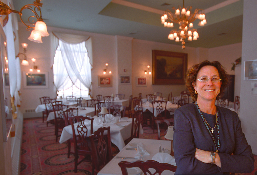 LANDMARK INN OWNER CHRISTINE PESOLA IN THE MARQUETTE MICHIGAN HOTEL'S HERITAGE ROOM DINING AREA.