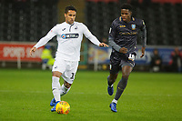 (L-R) Wayne Routledge of Swansea City closely followed by Lucas Joao of Sheffield Wednesday during the Sky Bet Championship match between Swansea City and Sheffield Wednesday at the Liberty Stadium , Swansea, Wales, UK. Saturday 15 December 2018