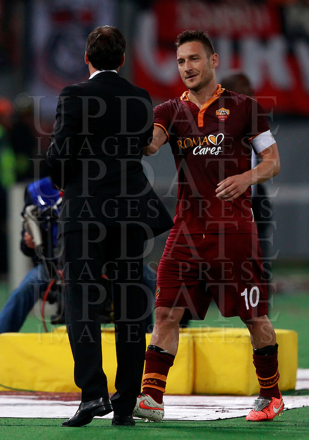 Calcio, Serie A: Roma vs Milan. Roma, stadio Olimpico, 25 aprile 2014.<br /> AS Roma coach Rudi Garcia, of France, left, greets captain Francesco Totti at the end of the Italian Serie A football match between AS Roma and AC Milan at Rome's Olympic stadium, 25 April 2014. AS Roma won 2-0.<br /> UPDATE IMAGES PRESS/Isabella Bonotto