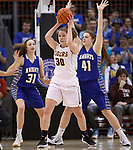 RAPID CITY, SD - MARCH 18, 2017 -- Jeniah Ugofsky #30 of Harrisburg works between Sioux Falls O'Gorman defenders Emma Ronsiek #31 and Courtney Baruth #41 during the 2017 South Dakota State Class AA Girls Basketball Championship game Saturday at Barnett Arena in Rapid City, S.D.  (Photo by Dick Carlson/Inertia)