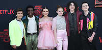 "28 June 2019 - Santa Monica, California - Gaten Matarazzo, Caleb McLaughlin, Millie Bobby Brown, Sadie Sink, Finn Wolfhard, Noah Schnapp. ""Stranger Things 3"" Los Angeles Premiere held at Santa Monica High School. Photo Credit: Birdie Thompson/AdMedia"