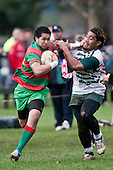 Saua Tavui tries to push off the tackle of Viliami Pola as he makes a run down the touchline. Counties Manukau Premier Semi-final rugby game between Manurew & Waiuku, played at Mountfort Park Manaurewa on Saturday 1st of August 2009..Waiuku won 23 - 3 and will meet Patumahoe in the final next week at Growers Stadium.
