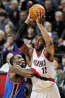 Portland Trail Blazers power forward LaMarcus Aldridge (12) shoots as Oklahoma City Thunder center Kendrick Perkins (left) defends during third quarter of NBA basketball game in Portland, Oregon,  February 6, 2012.  REUTERS/Steve Dipaola (UNITED STATES)