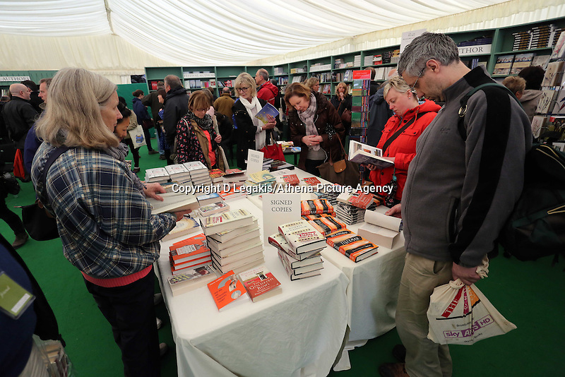 Saturday 24 May 2014, Hay on Wye UK<br /> Pictured: Festival-goers browsing the the book store.<br /> Re: The Telegraph Hay Festival, Hay on Wye, Powys, Wales UK.