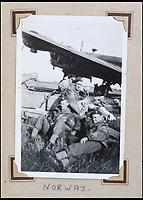 BNPS.co.uk (01202 558833)<br /> Pic: Bellmans/BNPS<br /> <br /> Relaxing on an airstrip in Norway.<br /> <br /> A fascinating trove of SAS records including some of the first photographs of the elite force which have never been seen before has been unearthed. <br /> <br /> The extensive assortment, also including medals and documents, was accumulated by war hero Lance Corporal William James Cooke at the end of World War Two. <br /> <br /> Remarkable images of Cooke's previously unrevealed wartime exploits show him serving behind enemy lines in occupied France and assisting with the liberation of Norway. <br /> <br /> His accomplishments have come to light after a family member presented the bequeathed collection to Hampshire-based auctioneer Bellmans, which will sell it tomorrow.