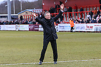 Chris Wilder (Manager) of Northampton Town applauds the travelling Northampton Town fans after the Sky Bet League 2 match between Stevenage and Northampton Town at the Lamex Stadium, Stevenage, England on 19 March 2016. Photo by David Horn / PRiME Media Images.