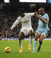 Picture: Andrew Roe/AHPIX LTD, Football, Barclays Premier League, Manchester City v Swansea City, 22/11/14, Etihad Stadium, K.O 3pm<br /> <br /> Swansea's Wilfried Bony palms off City's Vincent Kompany<br /> <br /> Andrew Roe>>>>>>>07826527594