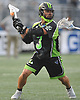 Rob Pannell #3 of the New York Lizards fakes a shot before making a pass during a Major League Lacrosse game against the Ohio Machine at Shuart Stadium in Hempstead, NY on Thursday, June 29, 2017.