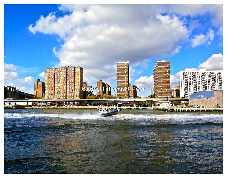 NEW YORK, NY - OCTOBER 18: Police boat on the East River followng President Barack Obama's motor brigade on Franklin D. Roosevelt East River Drive on October 18, 2012 in New York, New York. Photo Credit: Thomas R. Pryor
