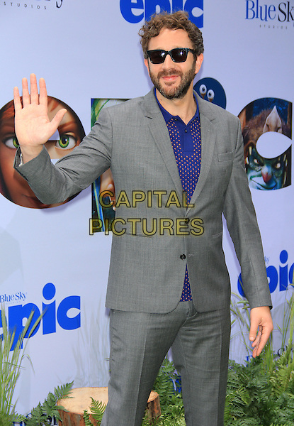 Chris O'Dowd.attending the New York film premiere of 'Epic' at the Ziegfeld Theatre, New York, NY, May 18th, 2013..half length grey gray suit blue shirt sunglasses hand waving .CAP/LNC/TOM.©TOM/LNC/Capital Pictures.