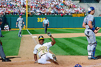 OAKLAND, CA - Rickey Henderson of the Oakland Athletics slides home safely during Game 3 of the American League Championship Series against the Toronto Blue Jays at the Oakland Coliseum in Oakland, California in 1992. Photo by Brad Mangin