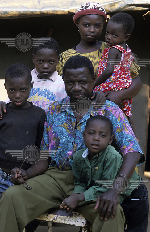 An HIV positive father sits with his family.