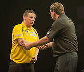 09.04.2015. Sheffield, England. Betway Premier League Darts. Matchday 10.  James Wade [ENG] congratulates Dave Chisnall [ENG] after the winning double in their match.